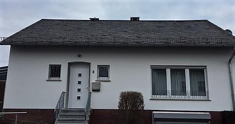 1 von 2 - Neueindeckung Dachfläche inkl. ausgestellter Kaminverkleidung mit Stehpfalz